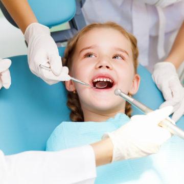 little girl at children's dentist